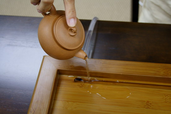 After 20 seconds, remove hot water from the warmed tea pot.