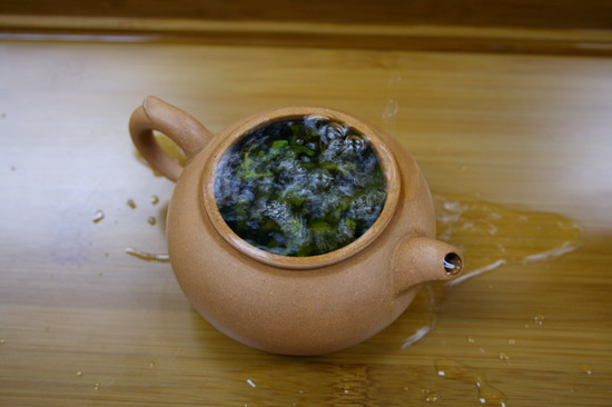 The tea leaves start expands in the tea pot and emit its aroma.